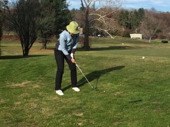 Golfing in the sun.